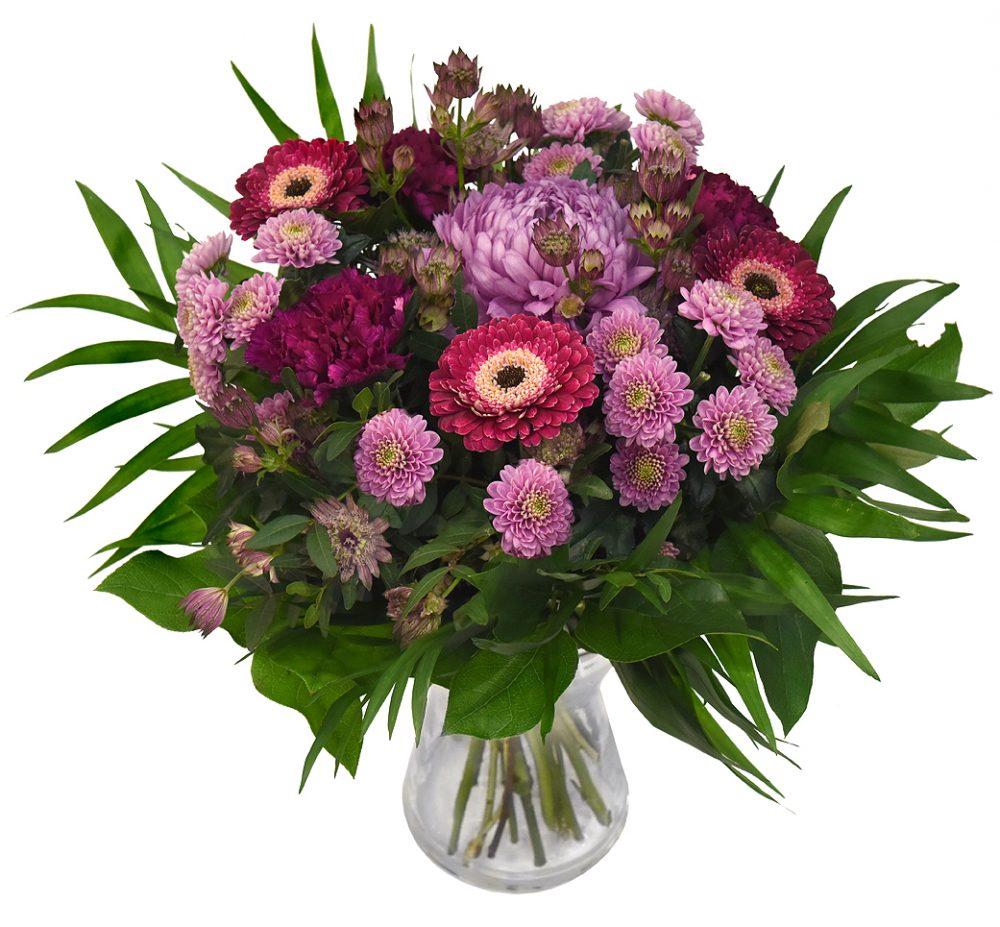 Rund Bukett med blommor i lila toner från bellis blomsterhandel