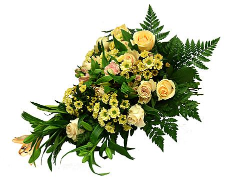 En neutral och enkel begravningsbukett med rosor, krysantemum och liljor hos Bellis blomsterhandel.