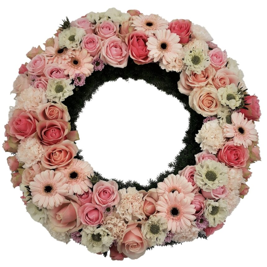 Begravningskrans med b.la rosor, gerbera, krysantemum hos Bellis blomsterhandel.